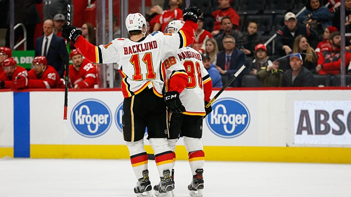 The Flames will continue to do man love hugging shit