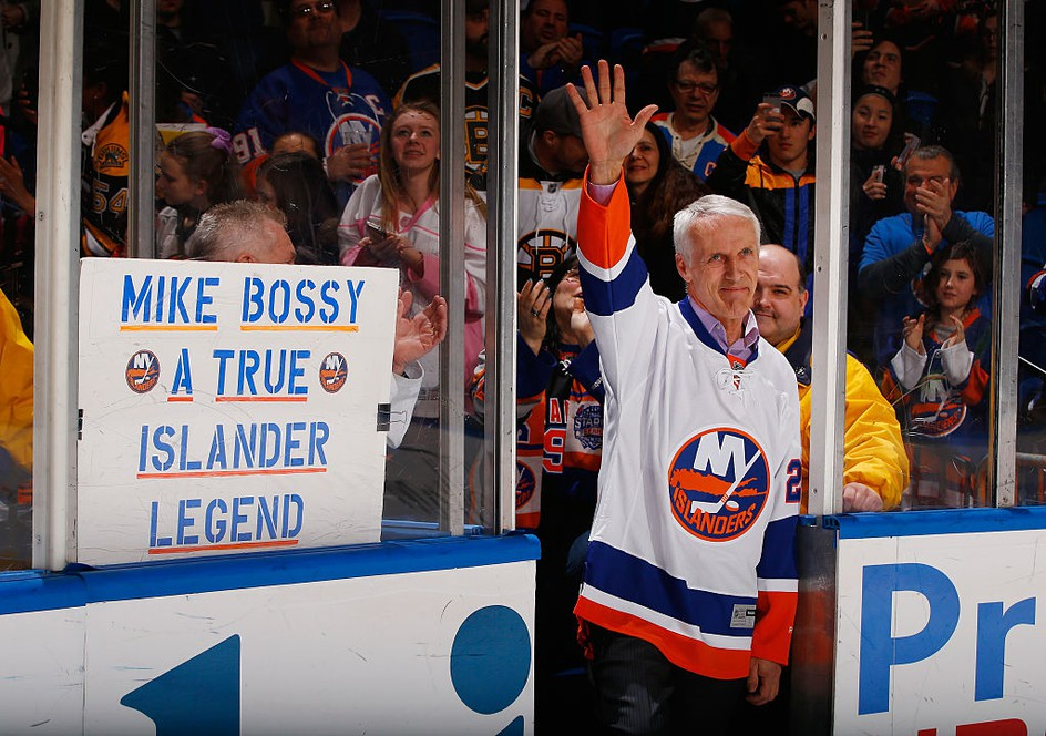 Former New York Islanders star Mike Bossy waves to the crowd prior to the game during Mike Bossy tribute night at the Nassau Veterans Memorial Coliseum on Jan. 29, 2015, in Uniondale, N.Y. AL BELLO/GETTY IMAGES