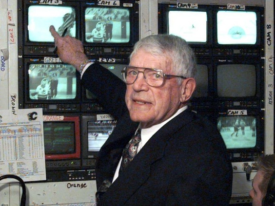 Howie Meeker checks out some of the camera shots in the TV truck outside GM Place in Vancouver during a 1998 game, his last telecast before retirement. PHOTO BY COLIN PRICE /Postmedia Network