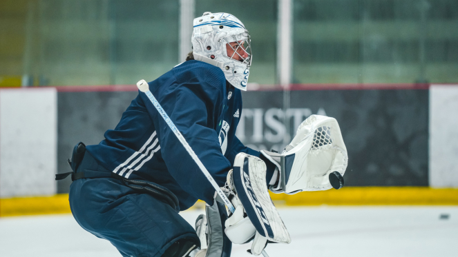 Jets goalie Connor Hellebuyck makes a stop during practice this week. / Winnipeg Jets