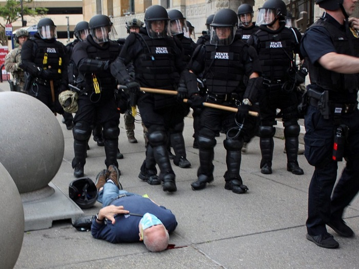 Martin Gugino, a 75-year-old protester, lays on the ground after he was shoved by two Buffalo police officers during a protest in Niagara Square in Buffalo June 4, 2020.Jamie Quinn / Handout via REUTERS
