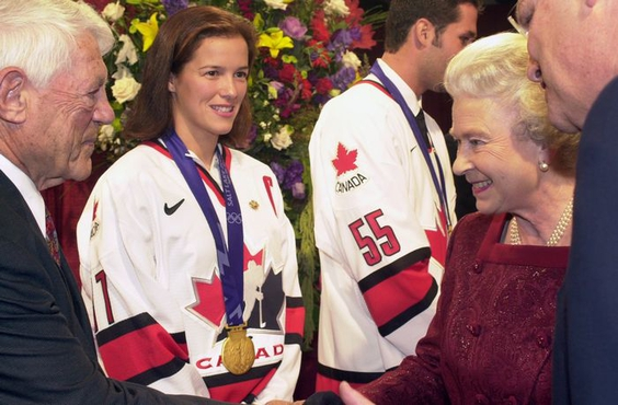 Howie Meeker (left, with Cassie Campbell and Ed Jovanovski) greeted Queen Elizabeth II before a puck drop ceremony on Oct. 6, 2002. PHOTO BY DENISE HOWARD /Vancouver Sun