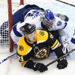 Tampa Bay Lightning goaltender Andrei Vasilevskiy lands on top of Nick Ritchie of the Boston Bruins during Eastern Conference round robin play on Wednesday. ANDRE RINGUETTE / Getty Images